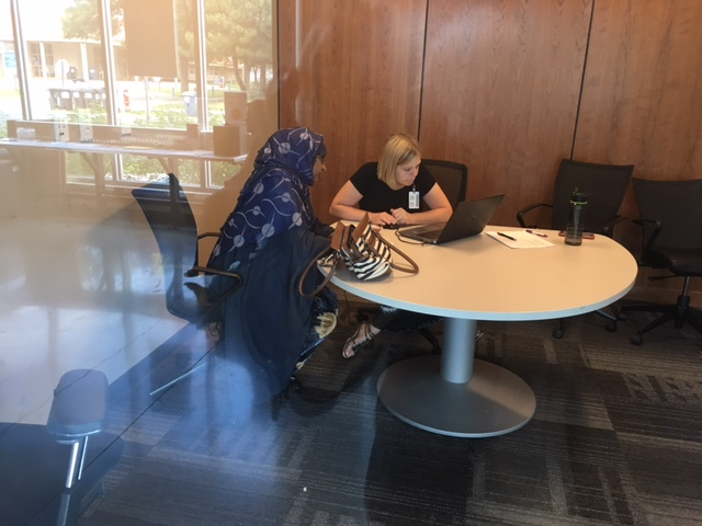 Regina Pekarek, right, meets with Cedar Riverside job seeker Saido Haji Abdulle