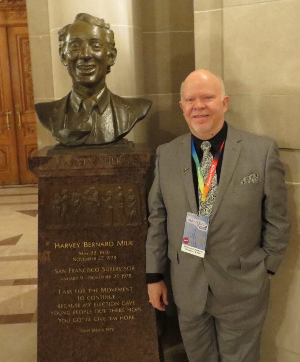 """Slade"" Childers, years later, beside the bust of Harvey Milk in San Francisco City Hall"