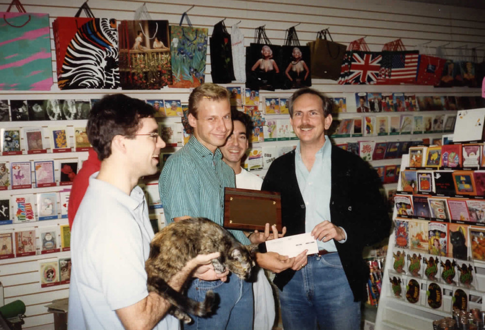 William Waybourn (black jacket) in Crossroads Market