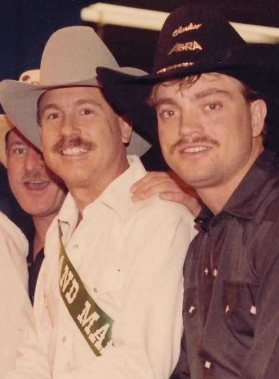 Don Baker (left, wearing sash) as Grand Marshall of Texas Gay Rodeo Association