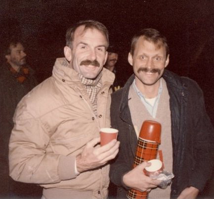 Terry Tebedo  (right) serving hot chocolate in the cold hours before sunrise. Partner  Bill Nelson  (left).