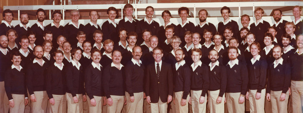 Rare photo of the original membership of the Turtle Creek Chorale in about 1983 performing at the The Great American Choral Festival in Dallas.  Roger Kennedy is in back row, 6th from the left.  John Thomas is the tallest singer on back row
