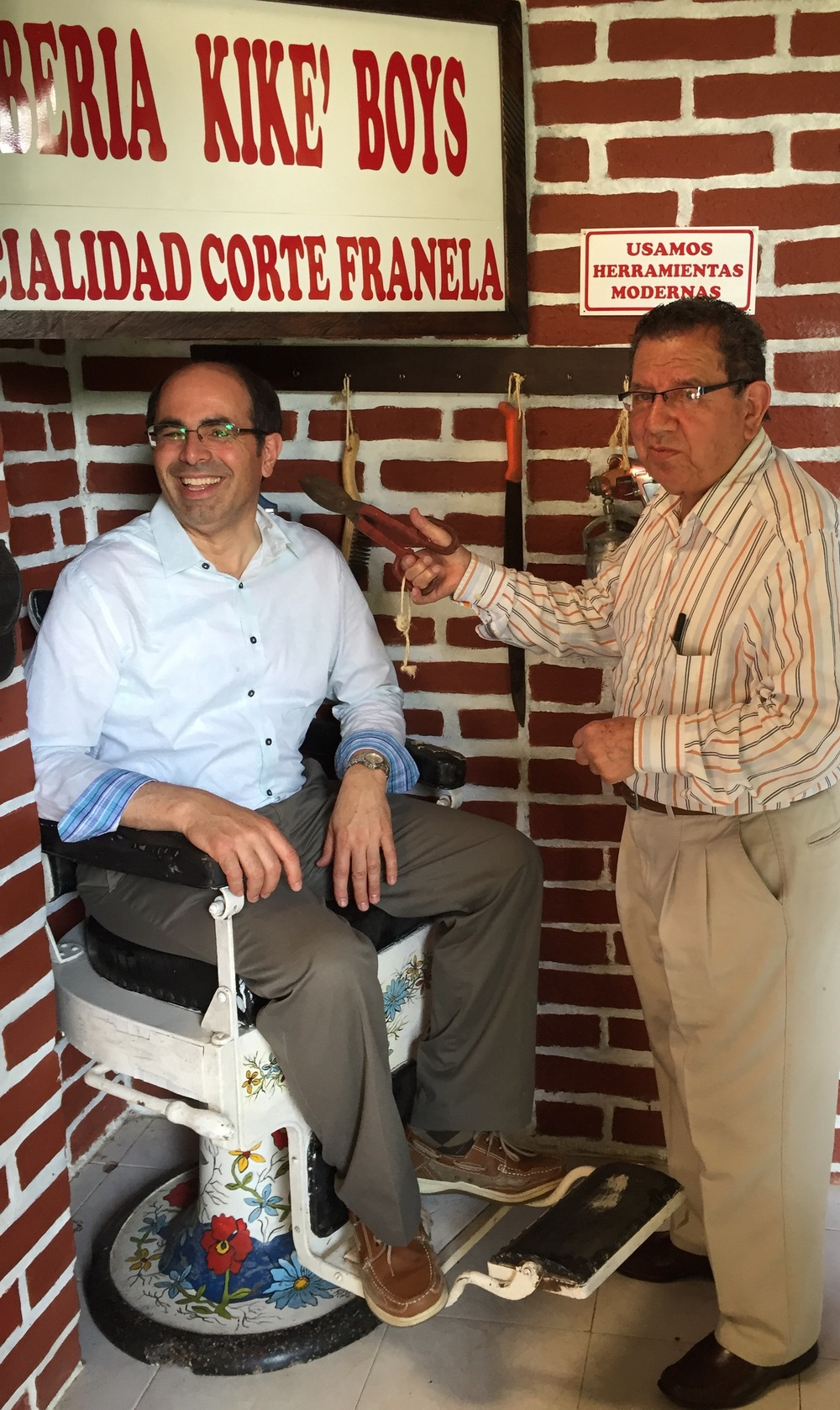 First time visitors to the farm sit in the antique Barber's chair for a photo.