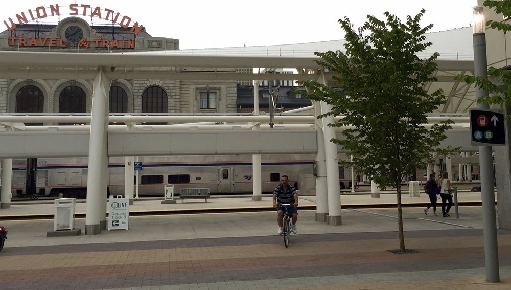After debarking the RTD Light Rail E Trail, it's a short city-block walk to Union Station. The University of Colorado 'A' train leaves for DIA on Track 1 (hidden behind the Amtrak train).