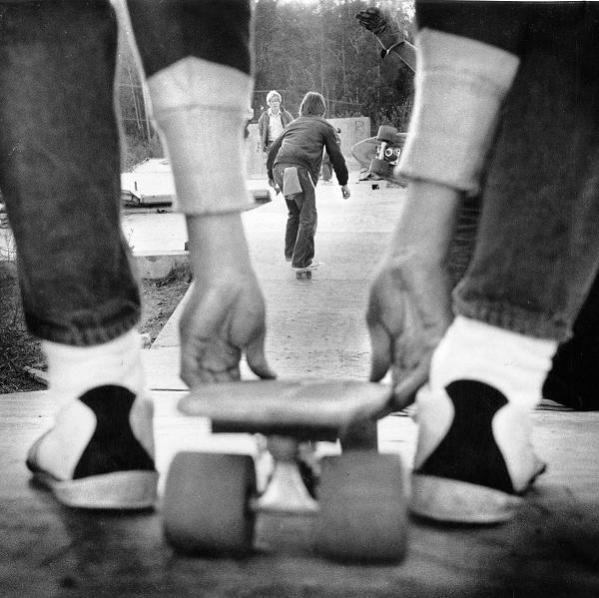 Kids skateboard down a makeshift ramp. Photo taken Dec. 1, 1976. Location not specified.