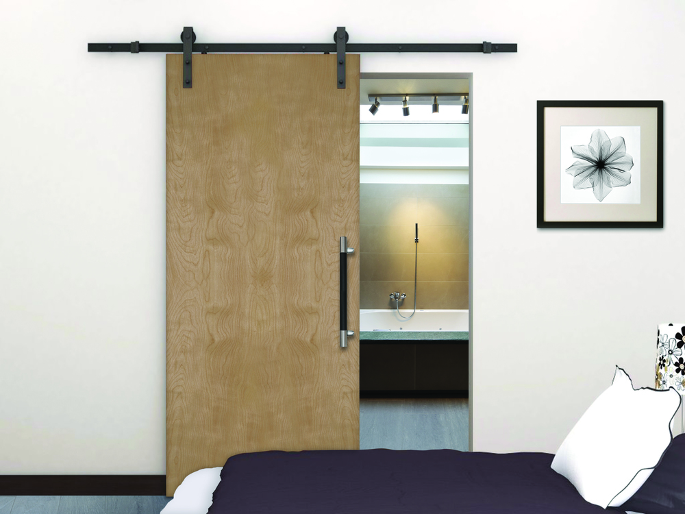 "Natural maple flush door on Acme Barn Track with Straight Strap Hangers in Bronce, and Rockwood SoftMet"" Offset Pull"