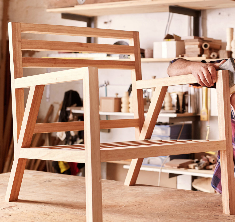 Cropped_Furniture Designer Sanding Wooden Chair Frame.jpg