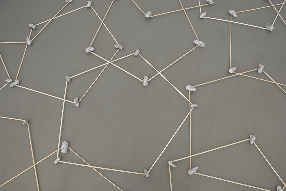 Floor Pentagons , 2010 Wood, cast aluminum, 36-inch diameter