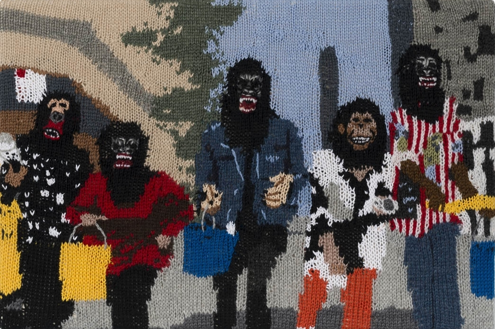 Feminist Fan #16 (Guerrilla Girls in New York City by George Lang, 1995) , 2015. Hand knitted wool and acrylic yarns, canvas and timber, 16 x 24 inches
