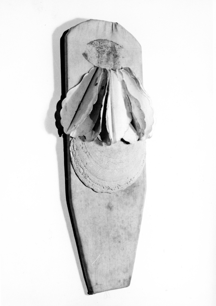 Padma Amulet,  1975, Cloth, shell, 16 x 5 3/8 inches