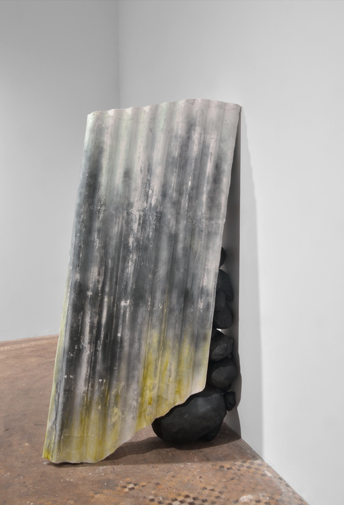 Retainer with Compressed Corrugation,  2014, graphite, plaster, resin, 67 x 16 x 26 inches