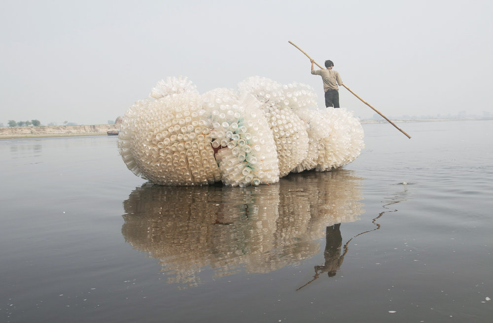 Indra's Cloud,  2008, Site-specific performance in Vrindavan, India using plastic water bottles, plastic rope, and boat, 8 x 14 x 6 feet