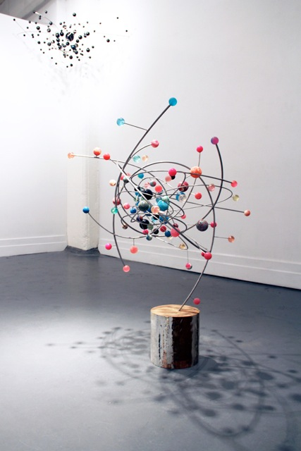 Still Point of the Turning World, 2012, Stainless steel, silver, bouncy balls, wood. 38 x 32 34 inches