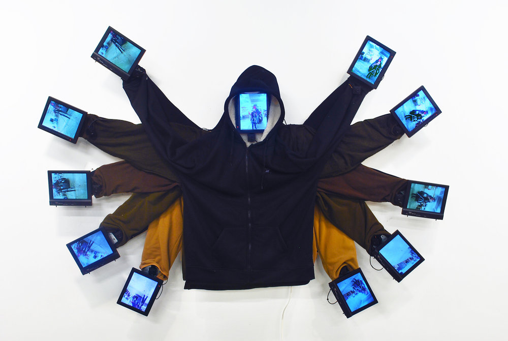 """Black Angel,"" video installation social sculpture, 2016. Mixed media, video cameras and monitors. Size: 72"" w x 12"" d.  https://vimeopro.com/fuzeart/black-angel"