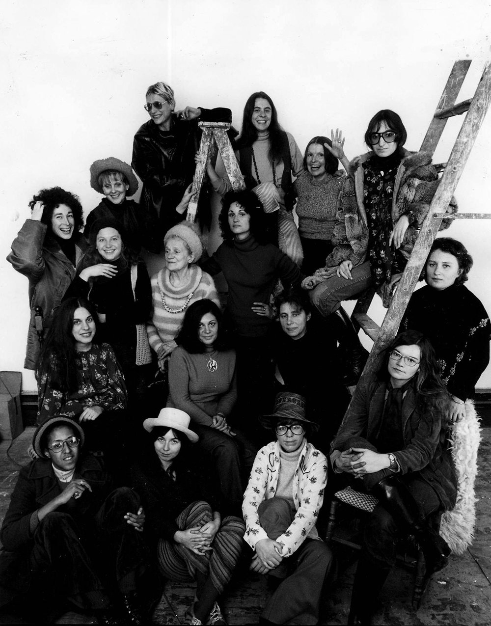 A.I.R Gallery founding members in Daria Dorosh's loft, 370 Broadway, 1974 Pictured from left to right, bottom to top: Howardena Pindell, Daria Dorosh, Maude Boltz, Rosemary Mayer, Mary Grigoriadis, Agnes Denes, Louise Kramer, Loretta Dunkelman, Barbara Zucker, Patsy Norvell, Sari Dienes, Judith Bernstein, Laurace James, Nancy Spero, Pat Lasch, Anne Healy, Dotty Attie.    Photo credit: David Attie