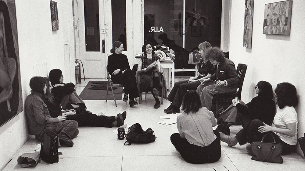 A.I.R's first gallery on  97 Wooster Street , 1974.  Pictured from left to right: Rachel bas-Cohain, Joan Snitzer, Kazuko Miyamoto, Blythe Bohnen, unidentified, Daria Dorosh, Laurace James, unidentified, Dotty Attie, Anne Healy.