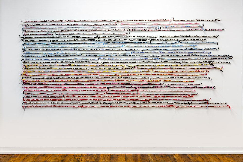 """Year In  (second view), 2017-18, wool felt, wire, 56"""" x 132"""""""