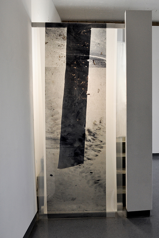 Hanging surface (layers)  2015, Closet transformed into a light box, digital prints on acetate and reflective mylar, illuminated with a light stand, 32 x 80 x 72 inches