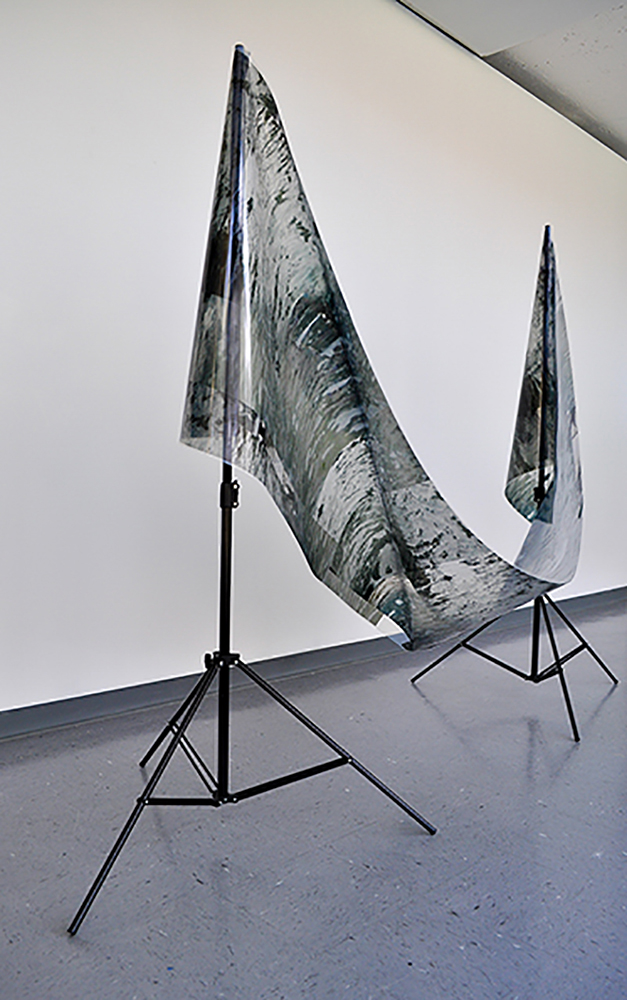 Flood prop II,  2014, Acetate digital composite print of flood waters draped on light kit stands, 36 x 70 x 80''