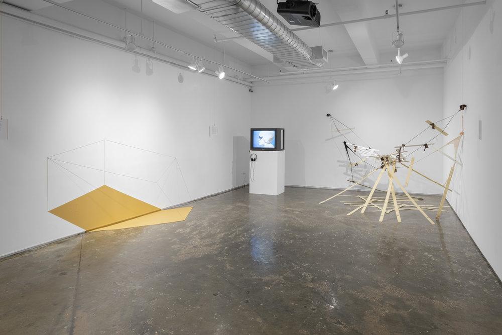 "Lydia Okumura, ""Diagram of the Cubicle Parallelogram,"" 1980, Howardena Pindell, ""Free, White and 21,"" 1980, and Senga Nengudi ""Nuki Nuki: Across 118th St,"" 1982/2014."