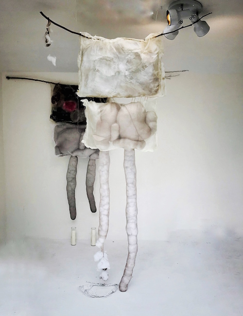 Strange Bodies 1 and 2 , Organza, wedding dress, nylon, bras stuffing, branches, candles, paint, resin, 7 feet tall x 5 feet wide x 4 feet apart, 2018