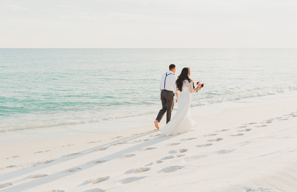opal beach wedding bride and groom walking pose