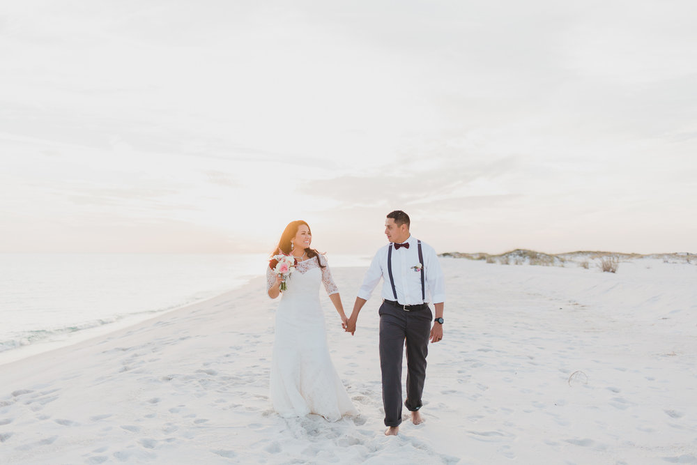 bride and groom lifestyle portraits on pensacola beach