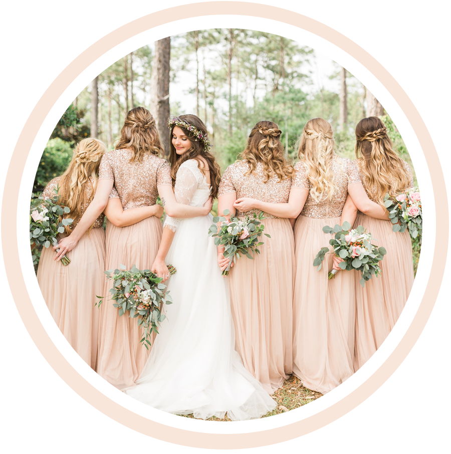 bridesmaids posing with whole foods florals in santa rosa beach