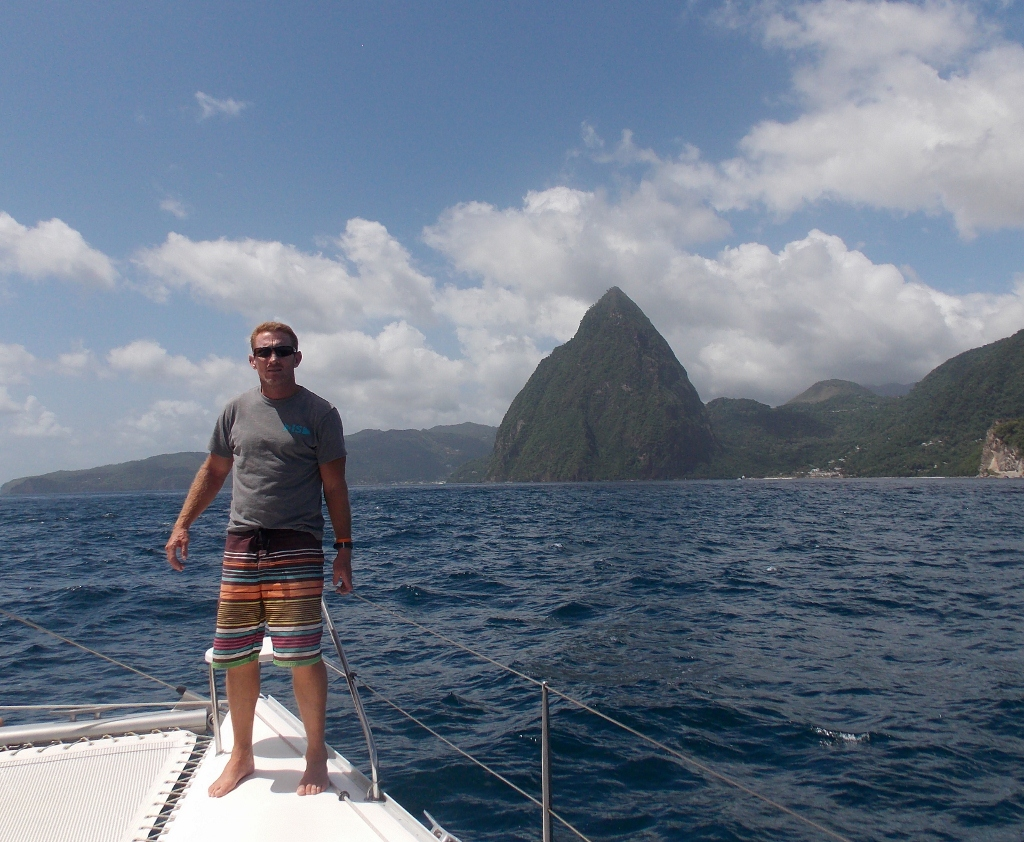Chris on bow entering Soufriere Bay with Petit Piton in the back