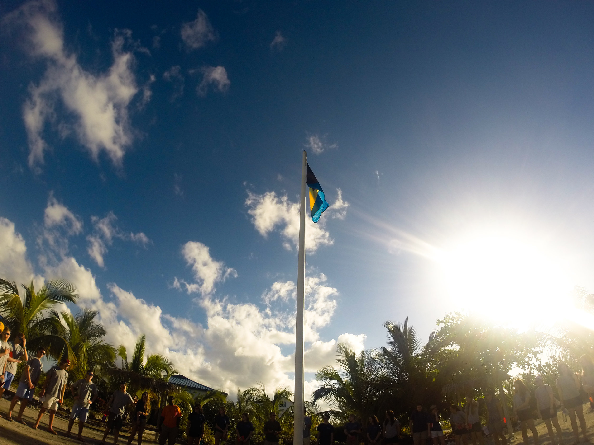 One of the first experiences at The Island School was gathering around the flagpole.