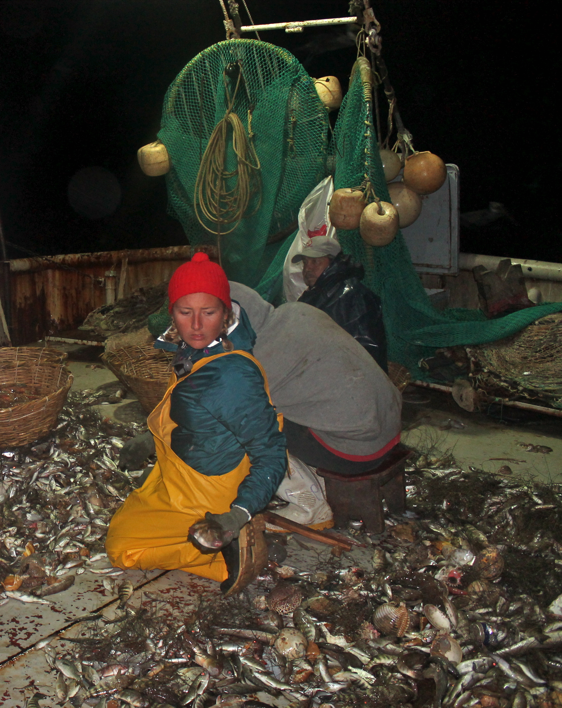 Ami working alongside fishermen on a shrimp trawler in the Gulf of California