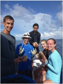 This group of students holds up deepwater Isopods (Bathynomus giganteus) during their afternoon research session.
