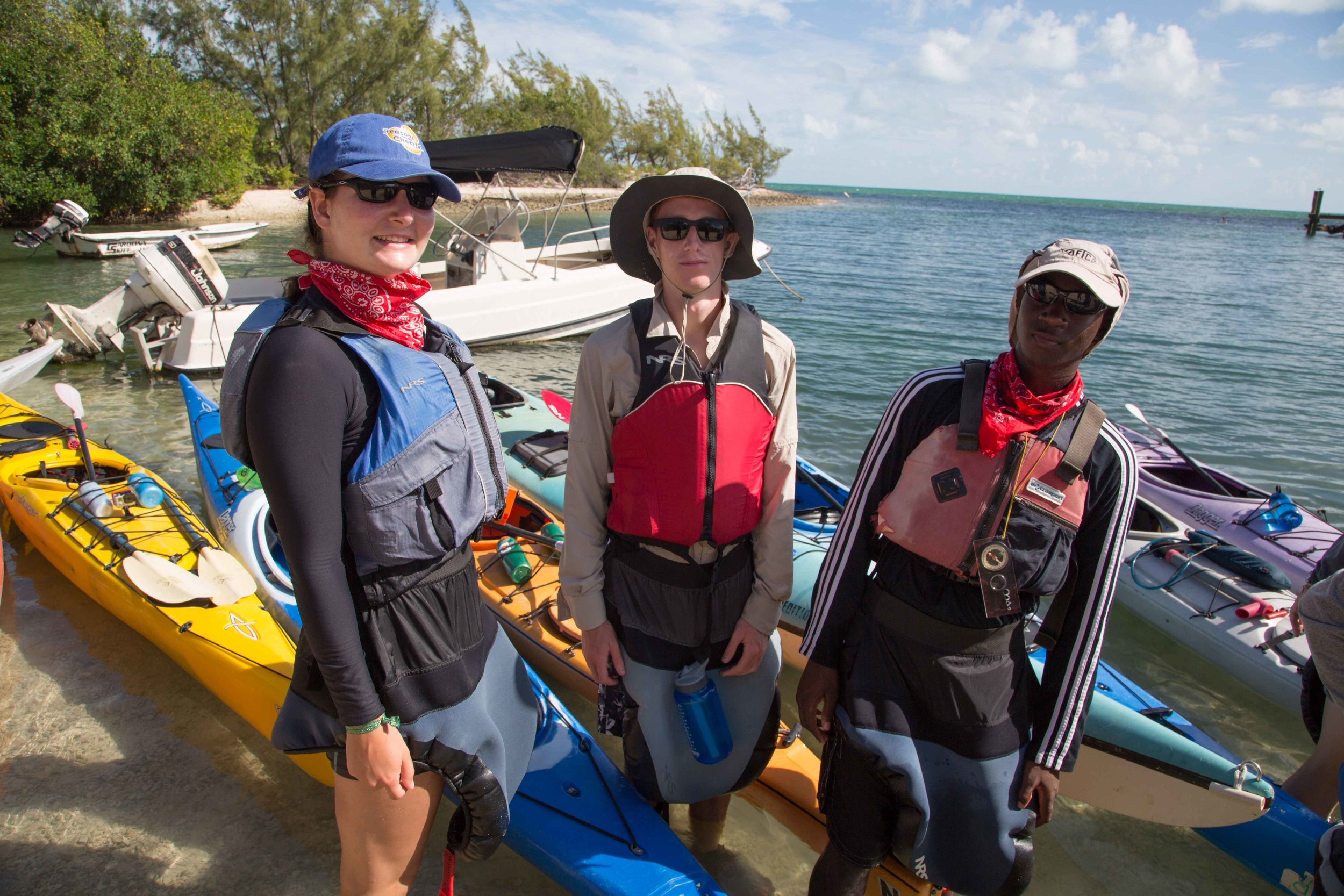 Kerwin, Ellie and Peter K. take a moment to pose for a photo before heading out on their kayak trip.