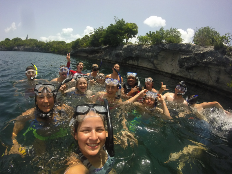 Students posing for a picture while snorkeling