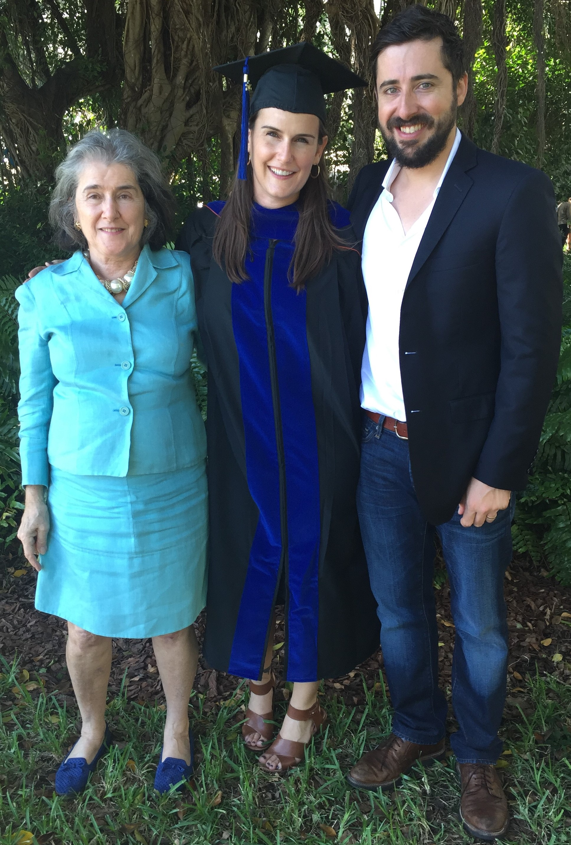 Francesca (center) with her mom (right) and husband (left) at her Ph.D. graduation ceremony