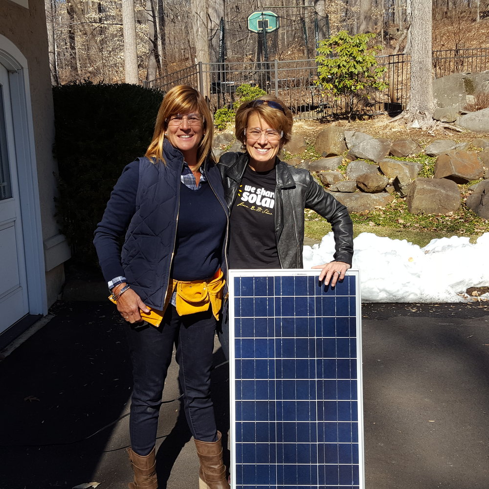 Pam Maxey and Gigi Goldman with the energy capture side of the solar suitcase, providing light for families and facilities in rural India through PPS.