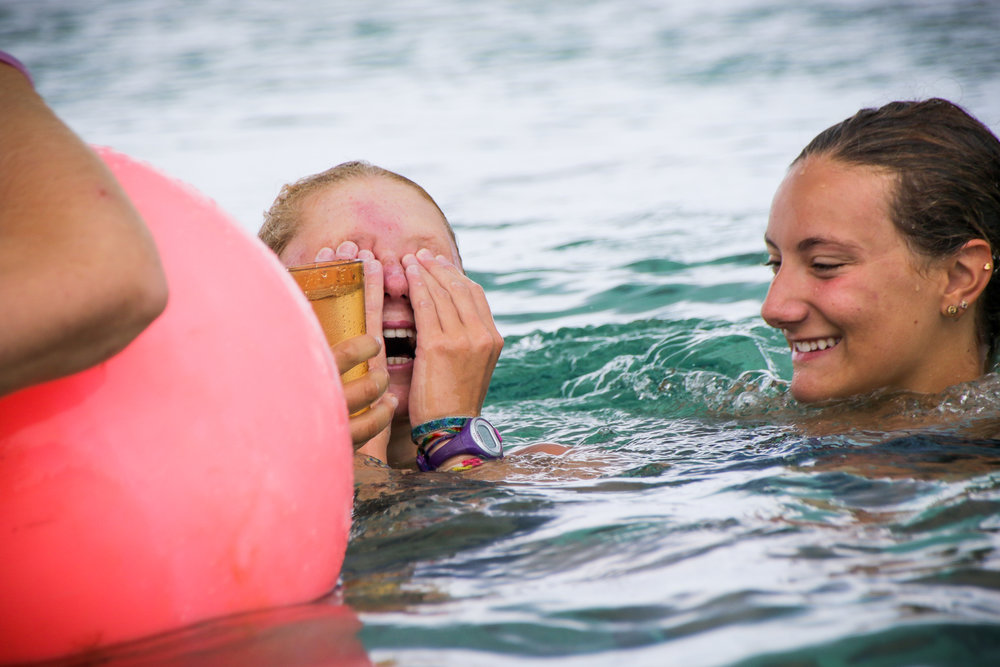 Margot Solvay and Lulu Bolles, right after touching the buoy that signified the end of the swim.