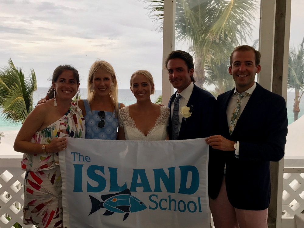 Lizzie Horvitz (SP'04), Hillary Keefe (SP'04), Hillary Bunn (SP'04), Andrew Gough (SP'04), and Patrick DiLoreto (F'04) celebrating Hillary Bunn's wedding on Harbor Island, Eleuthera.