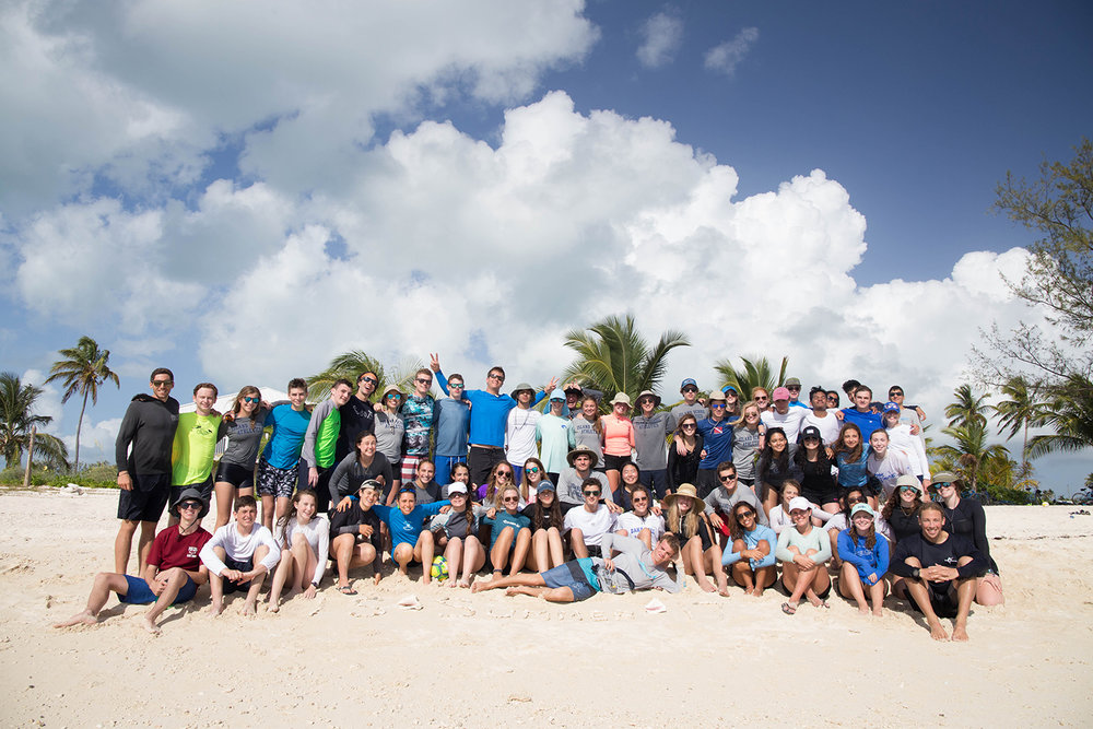 Students pose for a group photo at Sunset Beach.