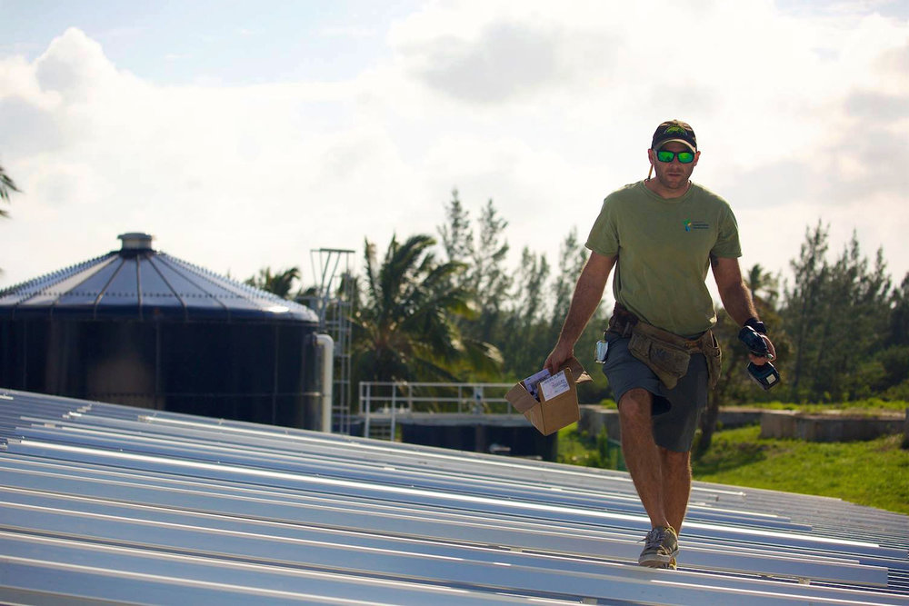 Mike Cortina works on a new solar array at the Cape Eleuthera Marina  -   Photo by Ben Kaufman