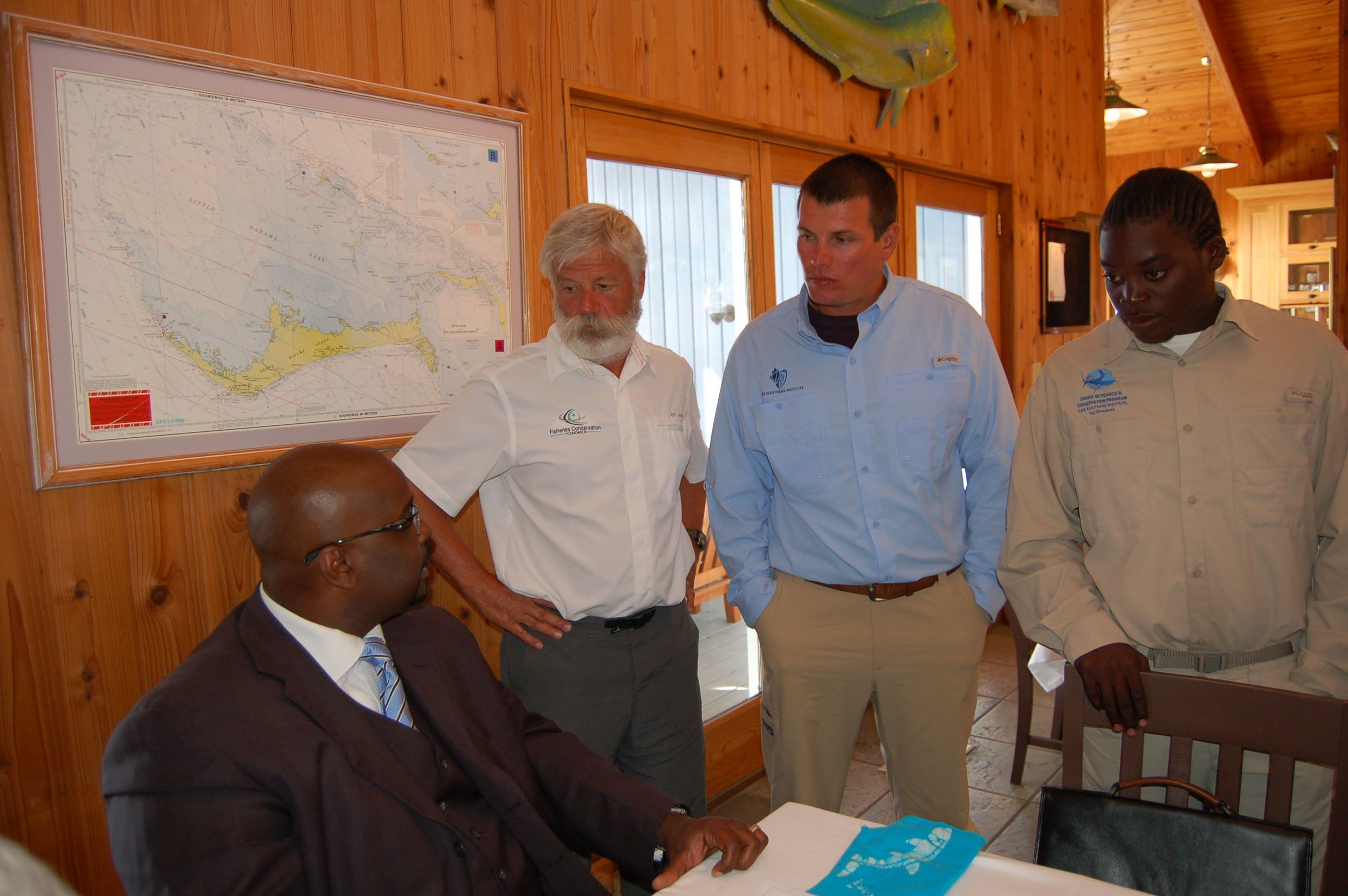 Aaron Shultz, David Philipp, and Malcolm Goodwin with the Prime Minister of the Bahamas