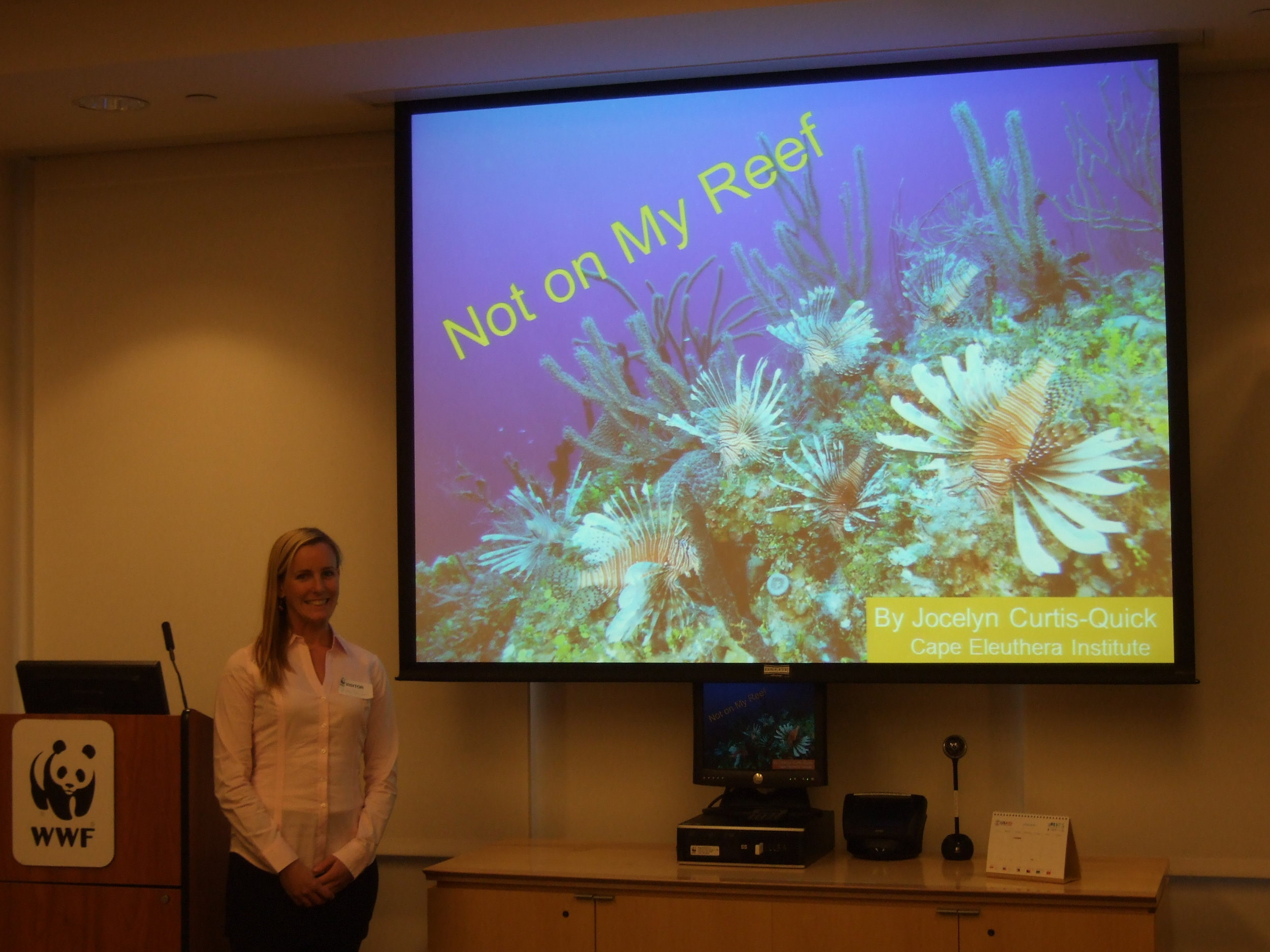 Dr. Jocelyn Curtis-Quick presenting CEI lionfish research for WWF D.C.