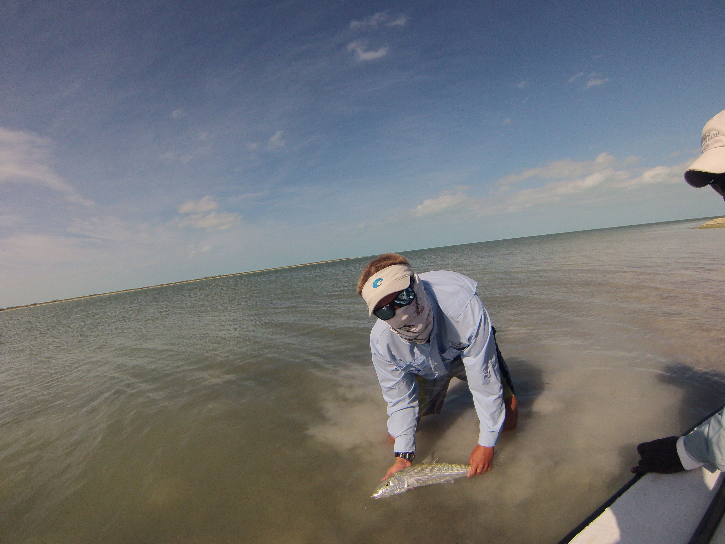 Sharks intern Carl Treyz catches his first bonefish on fly.