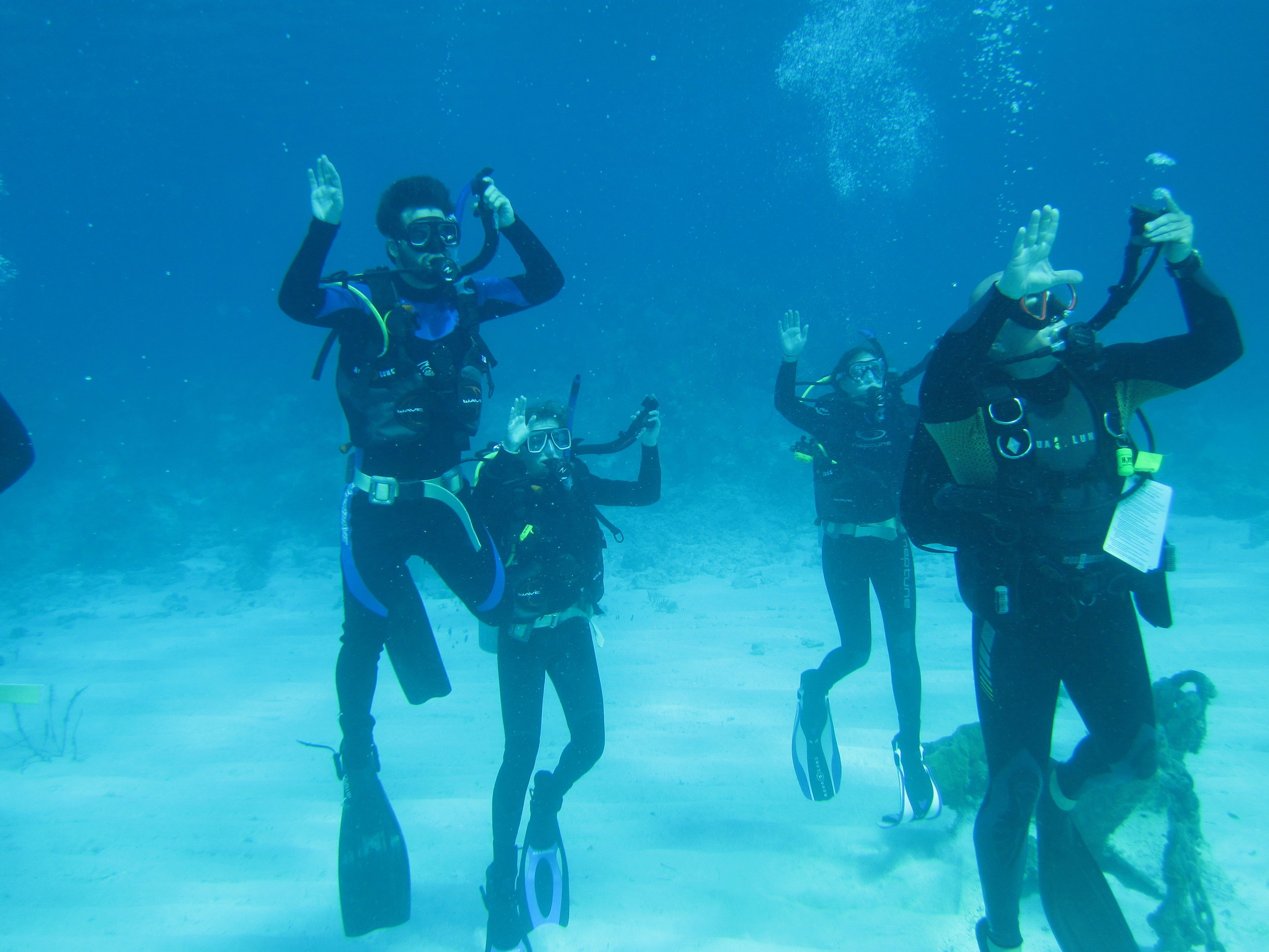 Team Gap learning to SCUBA dive with Ron