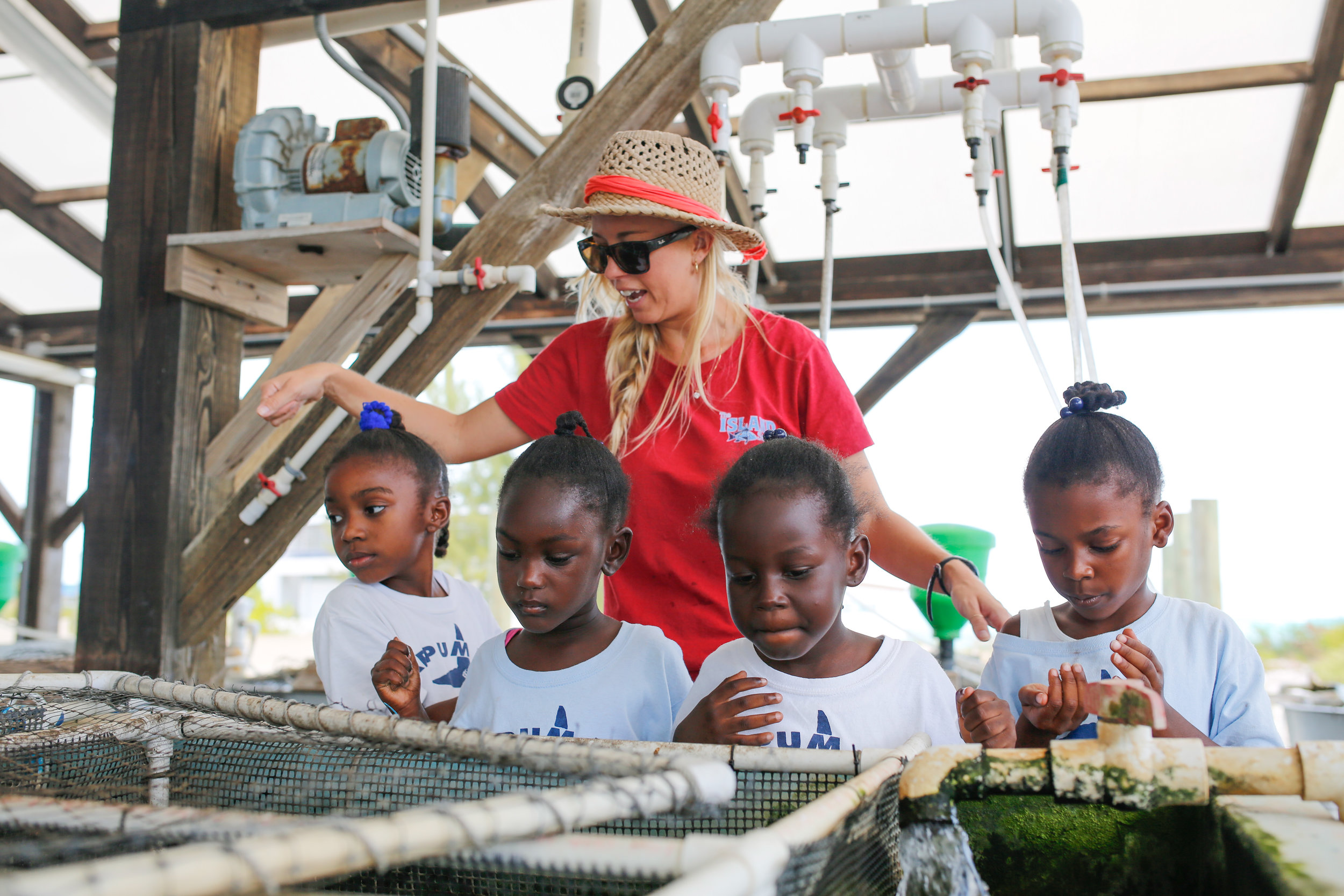 Educational Programs Lead Teacher Tiffany Gray demonstrates how the tilapia aquaculture system works