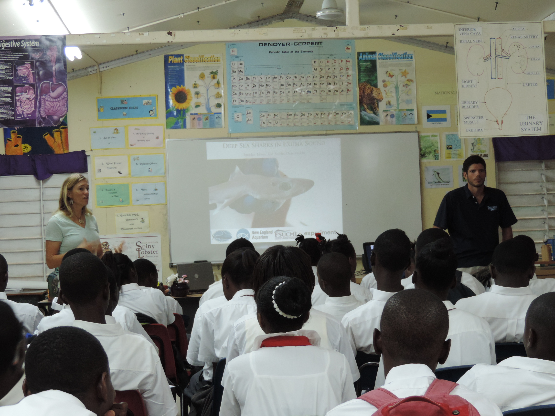 Catherine Booker (Exuma Foundation/Community Conch) introduces Brendan Talwar (FSU/CEI) to an eighth grade science class at LN Coakley Secondary High School