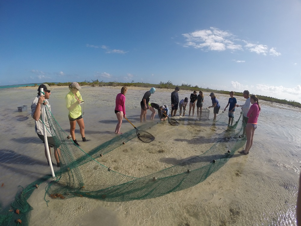 The Flats team with Berkshire High School seining bonefish