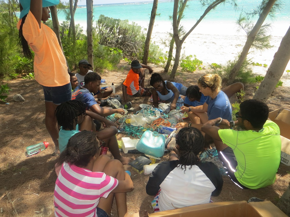 Sorting the plastics we collected at Cotton Bay Beach