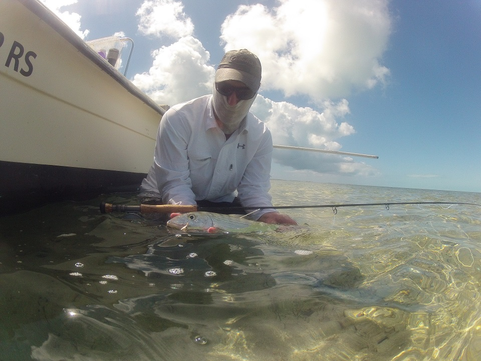 Zach Zuckerman holding a bonefish caught at Poison flats.