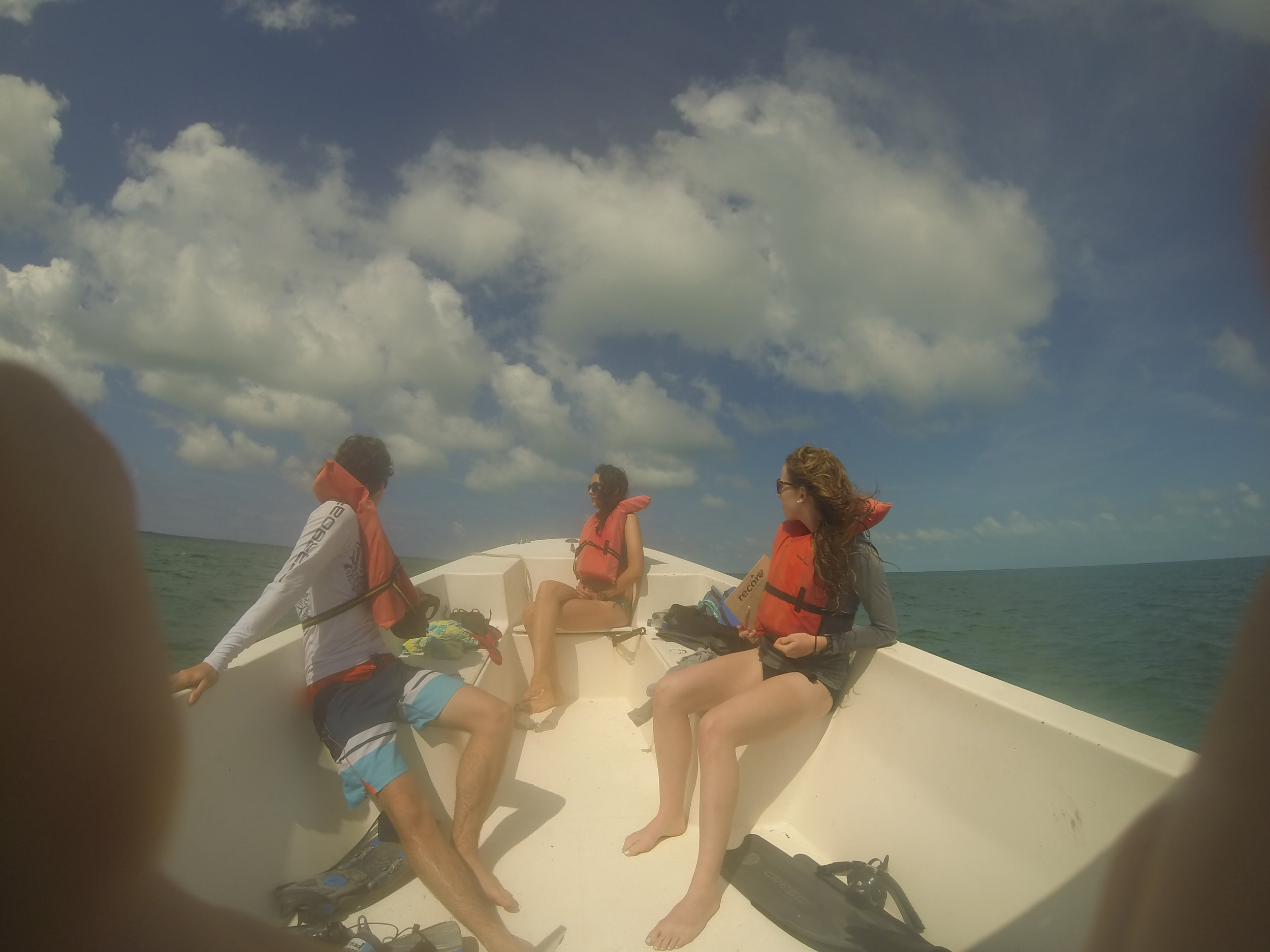 Students out on a boat on their way to the patch reefs